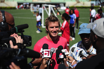 PORT OF SPAIN, TRINIDAD AND TOBAGO - SEPTEMBER 26:  David Beckham and FIFA Vice President and CONCACAF President Jack Warner speak to media during a Training Session for local players at the Marvin Lee Stadium on September 26, 2010 in Macoya, Trinidad And