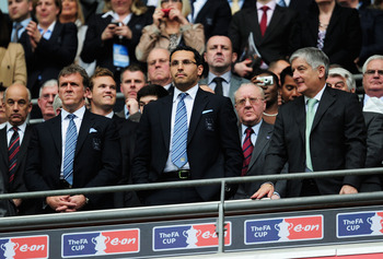 LONDON, ENGLAND - APRIL 16:  FA Chairman David Bernstein (R), Manchester City Chairman Khaldoon Al Mubarak (C) and Chief Executive Garry Cook look on prior to the FA Cup sponsored by E.ON semi final match between Manchester City and Manchester United at W