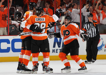 PHILADELPHIA, PA - APRIL 26:  Braydon Coburn #5, Claude Giroux #28 and Danny Briere #48 of the Philadelphia Flyers celebrate a first period goal against the Buffalo Sabres in Game Seven of the Eastern Conference Quarterfinals during the 2011 NHL Stanley C