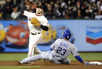 SAN FRANCISCO, CA - APRIL 13: Casey Blake #23 of the Los Angeles Dodgers slides into Mike Fontenot  #14 of the San Francisco Giants, breaking up a double play during a MLB baseball game at AT&T Park April 13, 2011 in San Francisco, California. (Photo by T