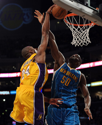 LOS ANGELES, CA - APRIL 26:  Kobe Bryant #24 of the Los Angeles Lakers dunks the ball over Emeka Okafor #50 of the New Orleans Hornets in the second quarter in Game Five of the Western Conference Quarterfinals in the 2011 NBA Playoffs on April 26, 2011 at