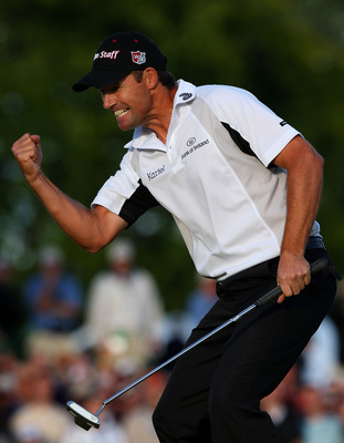 BLOOMFIELD HILLS, MI - AUGUST 10:  Padraig Harrington of Ireland celebrates with a fist pump after making par on the 18th hole during the final round of the 90th PGA Championship at Oakland Hills Country Club on August 10, 2008 in Bloomfield Township, Mic