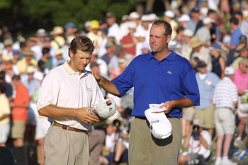 17 Jun 2001:  Retief Goosen of South Africa commiserates with Stewart Cink on the 18th green during the final round of the 101st US Open at Southern Hills Country Club in Tulsa, Oklahoma. DIGITAL IMAGE Mandatory Credit: Jamie Squire/ALLSPORT