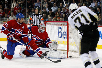 MONTREAL, CANADA - JANUARY 12:  Carey Price #31 and Hal Gill #75 of the Montreal Canadiens watch the puck hit the post on a shot by Evgeni Malkin #71 of the Pittsburgh Penguins during the NHL game at the Bell Centre on January 12, 2011 in Montreal, Quebec