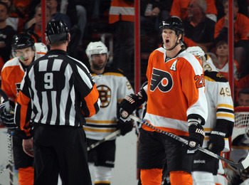 PHILADELPHIA, PA - APRIL 30: Chris Pronger #20 of the Philadelphia Flyers argues a call with referee Dan O'Rourke #9 in Game One against the Boston Bruins  of the Eastern Conference Semifinals during the 2011 NHL Stanley Cup Playoffs at the Wells Fargo Ce
