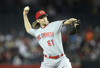 PHOENIX, AZ - APRIL 09:  Starting pitcher Bronson Arroyo #61 of the Cincinnati Reds pitches against the Arizona Diamondbacks during the Major League Baseball game at Chase Field on April 9, 2011 in Phoenix, Arizona. The Reds defeated the Diamondbacks 6-1.