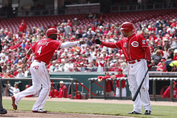CINCINNATI, OH - APRIL 21: Brandon Phillips #4 of the Cincinnati Reds celebrates with Miguel Cairo #43 after being walked home in the first inning of the game against the Arizona Diamondbacks at Great American Ball Park on April 21, 2011 in Cincinnati, Oh