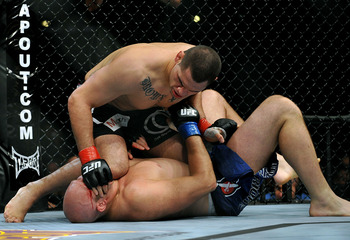 LOS ANGELES, CA - OCTOBER 24:  UFC fighter Cain Velasquez (top) battles with UFC fighter Ben Rothwell (bottom) during their Heavyweight bout at UFC 104: Machida vs. Shogun at Staples Center on October 24, 2009 in Los Angeles, California.  (Photo by Jon Ko