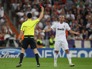 MADRID, SPAIN - APRIL 27:  Pepe of Real Madrid is sent off by Wolfgang Stark during the UEFA Champions League Semi Final first leg match between Real Madrid and Barcelona at Estadio Santiago Bernabeu on April 27, 2011 in Madrid, Spain.  (Photo by Alex Liv