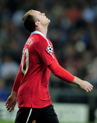 GELSENKIRCHEN, GERMANY - APRIL 26:  Wayne Rooney of Manchester United reacts during the UEFA Champions League Semi Final first leg match between FC Schalke 04 and Manchester United at Veltins Arena on April 26, 2011 in Gelsenkirchen, Germany.  (Photo by J