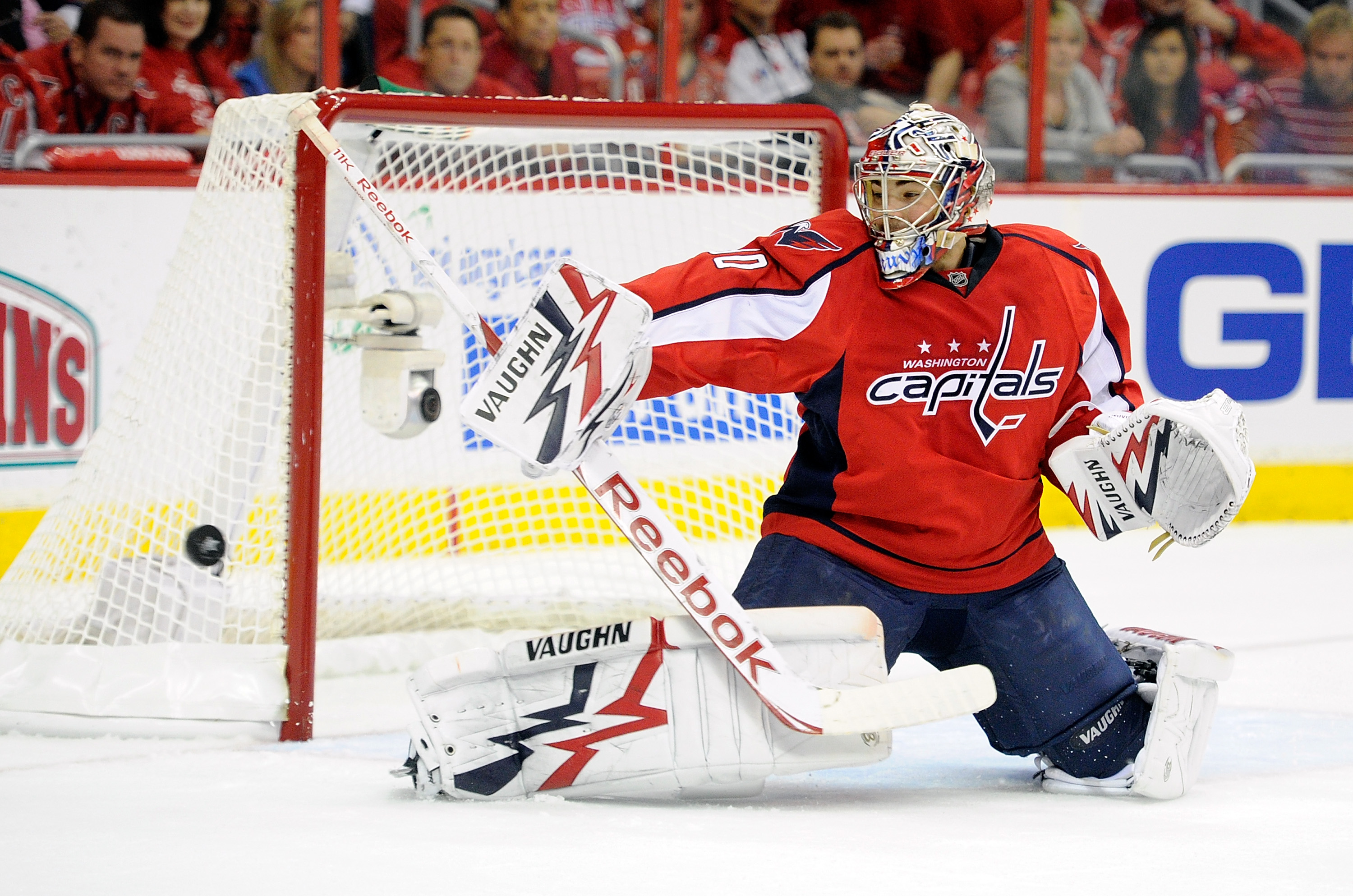 WASHINGTON, DC - APRIL 29:  Michal Neuvirth #30 of the Washington Capitals makes a save against the Tampa Bay Lightning during Game One of the Eastern Conference Semifinal during the 2011 NHL Stanley Cup Finals at the Verizon Center on April 29, 2011 in W