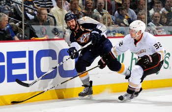 NASHVILLE, TN - APRIL 20:  Shea Weber #6 of the Nashville Predators dumps the puck in past Toni Lydman #32 of the Anaheim Ducks in Game Four of the Western Conference Quarterfinals during the 2011 NHL Stanley Cup Playoffs at Bridgestone Arena on April 20,