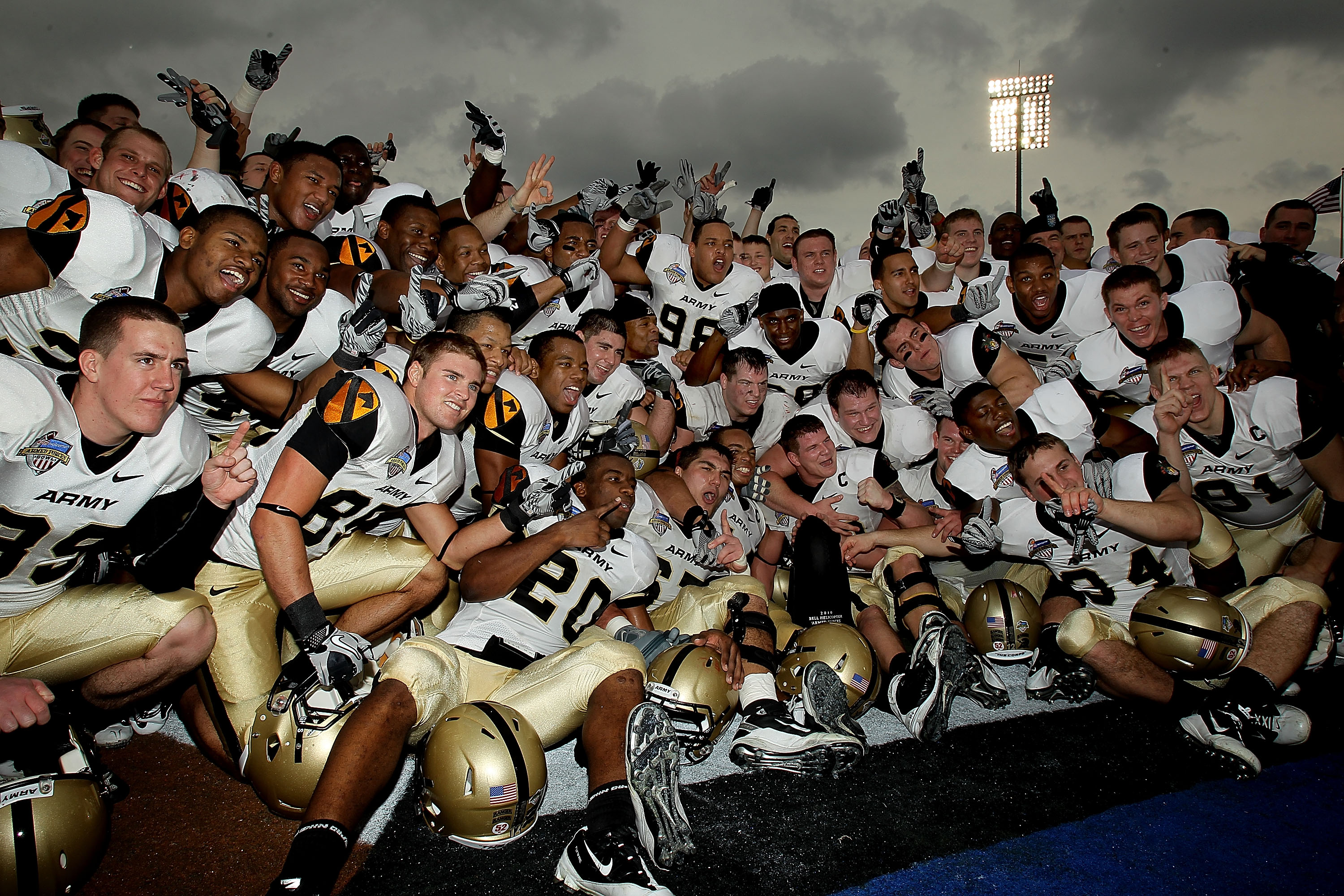 DALLAS, TX - DECEMBER 30:  The Army Black Knights celebrate a 16-14 win against the SMU Mustangs during the Bell Helicopter Armed Forces Bowl at Gerald J. Ford Stadium on December 30, 2010 in Dallas, Texas.  (Photo by Ronald Martinez/Getty Images)
