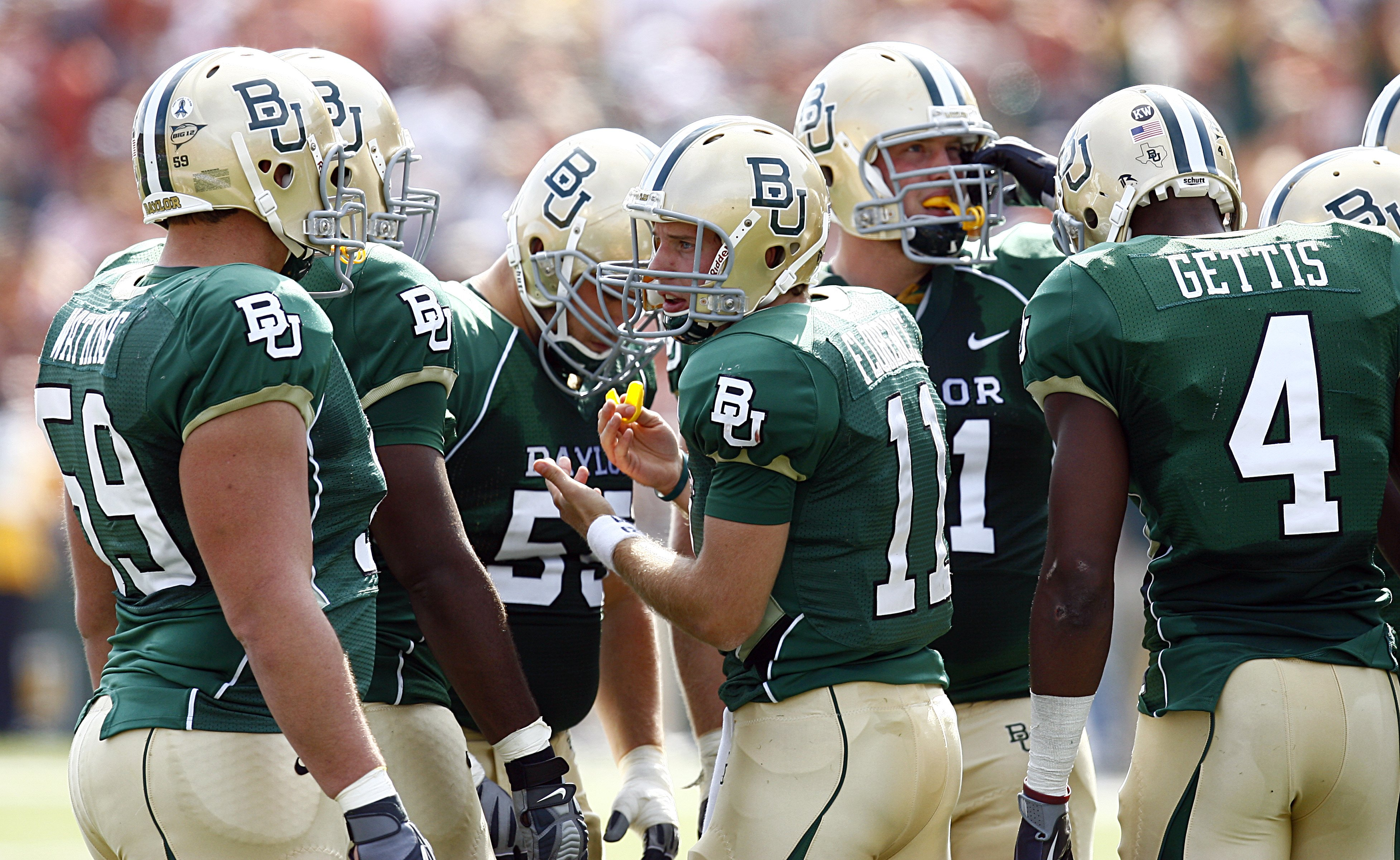 WACO, TX - NOVEMBER 14:  Quarterback Nick Florence #11 of the Baylor Bears leads his team in the huddle against the Texas Longhorns in the second half on November 14, 2009 at Floyd Casey Stadium in Waco, Texas. (Photo by Tom Pennington/Getty Images)