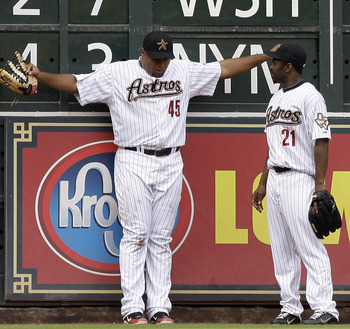Carlos Lee showing off his figure to teammate Michael Bourn.