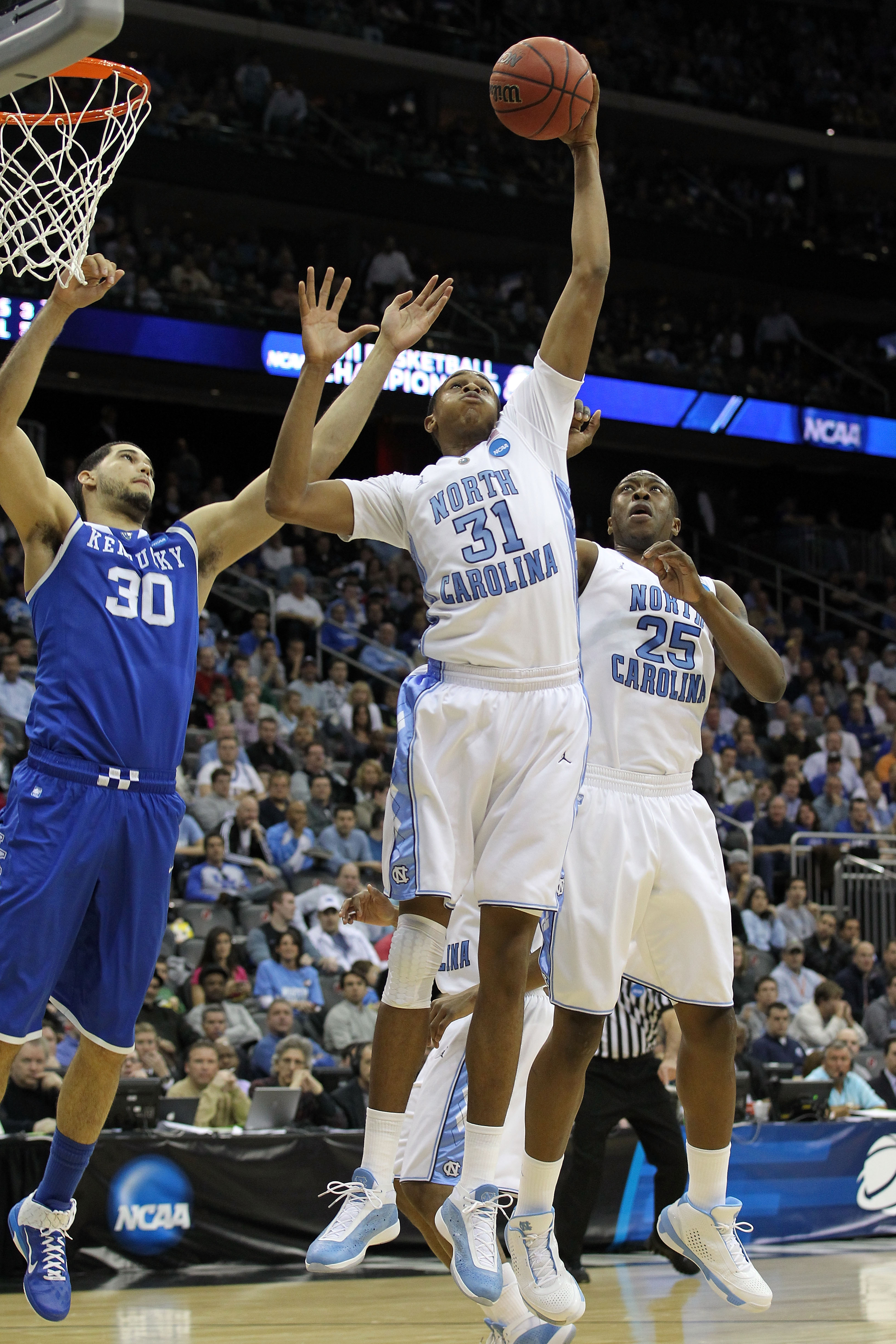 NEWARK, NJ - MARCH 27:  John Henson #31 of the North Carolina Tar Heels in action against Eloy Vargas #30 of the Kentucky Wildcats during the east regional final of the 2011 NCAA men's basketball tournament at Prudential Center on March 27, 2011 in Newark