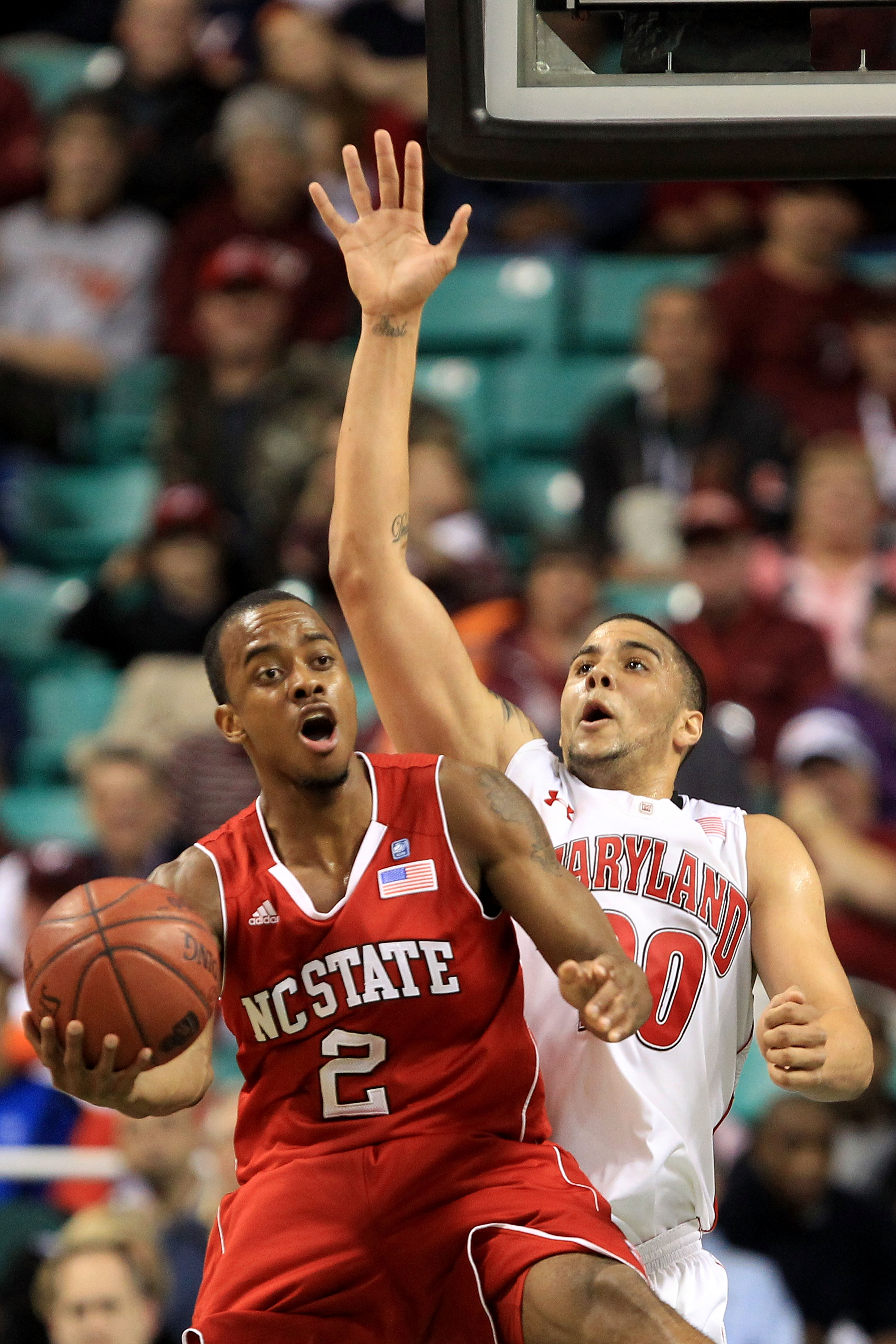 GREENSBORO, NC - MARCH 10:  Lorenzo Brown #2 of the North Carolina State Wolfpack reacts as he is blocked by Jordan Williams #20 of the Maryland Terrapins during the first round of the 2011 ACC men's basketball tournament at the Greensboro Coliseum on Mar