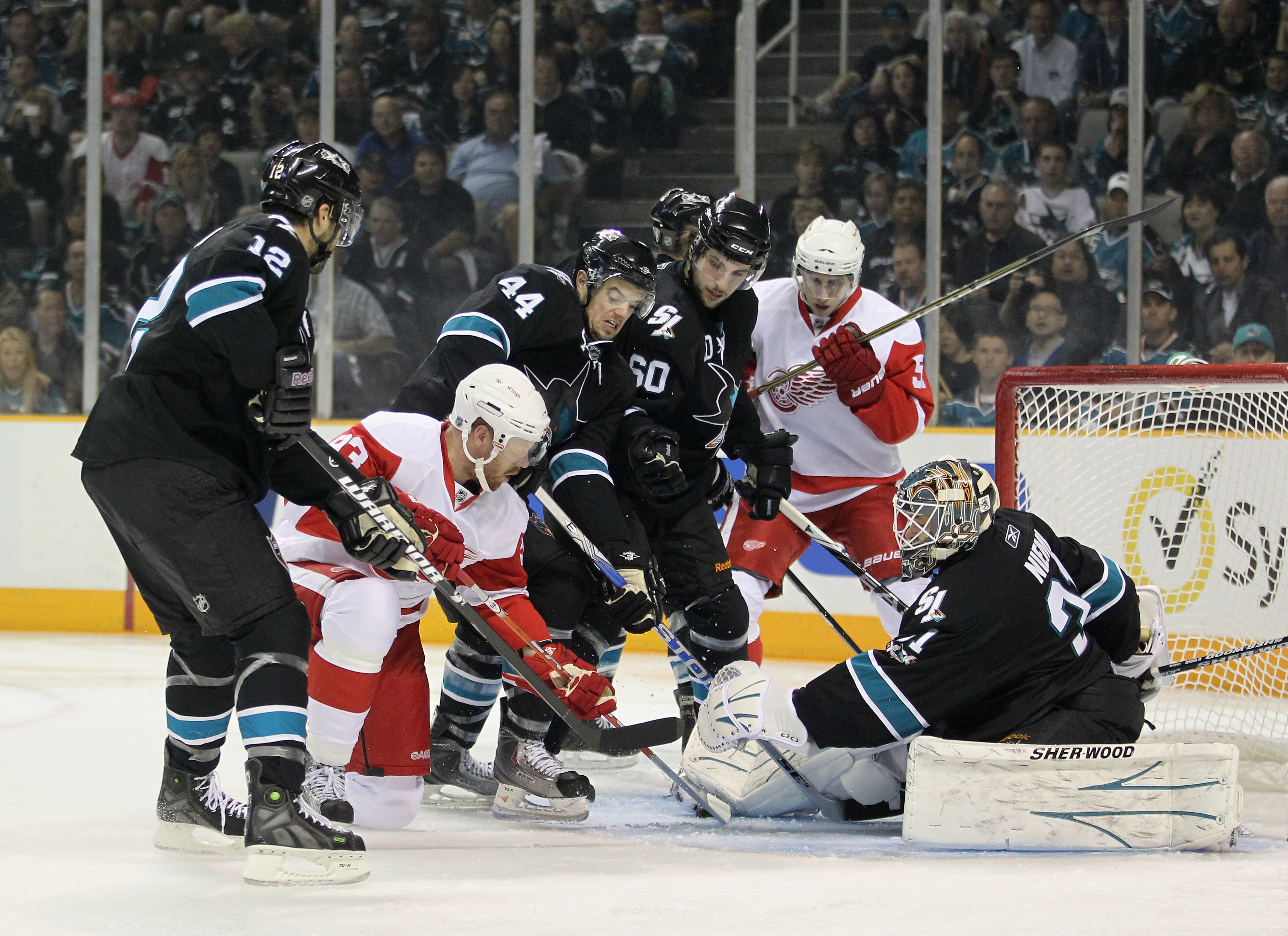 SAN JOSE, CA - MAY 01:  Antti Niemi #31 of the San Jose Sharks and the San Jose defense stop Johan Franzen #93 of the Detroit Red Wings from scoring in Game Two of the Western Conference Semifinals during the 2011 NHL Stanley Cup Playoffs at HP Pavilion o