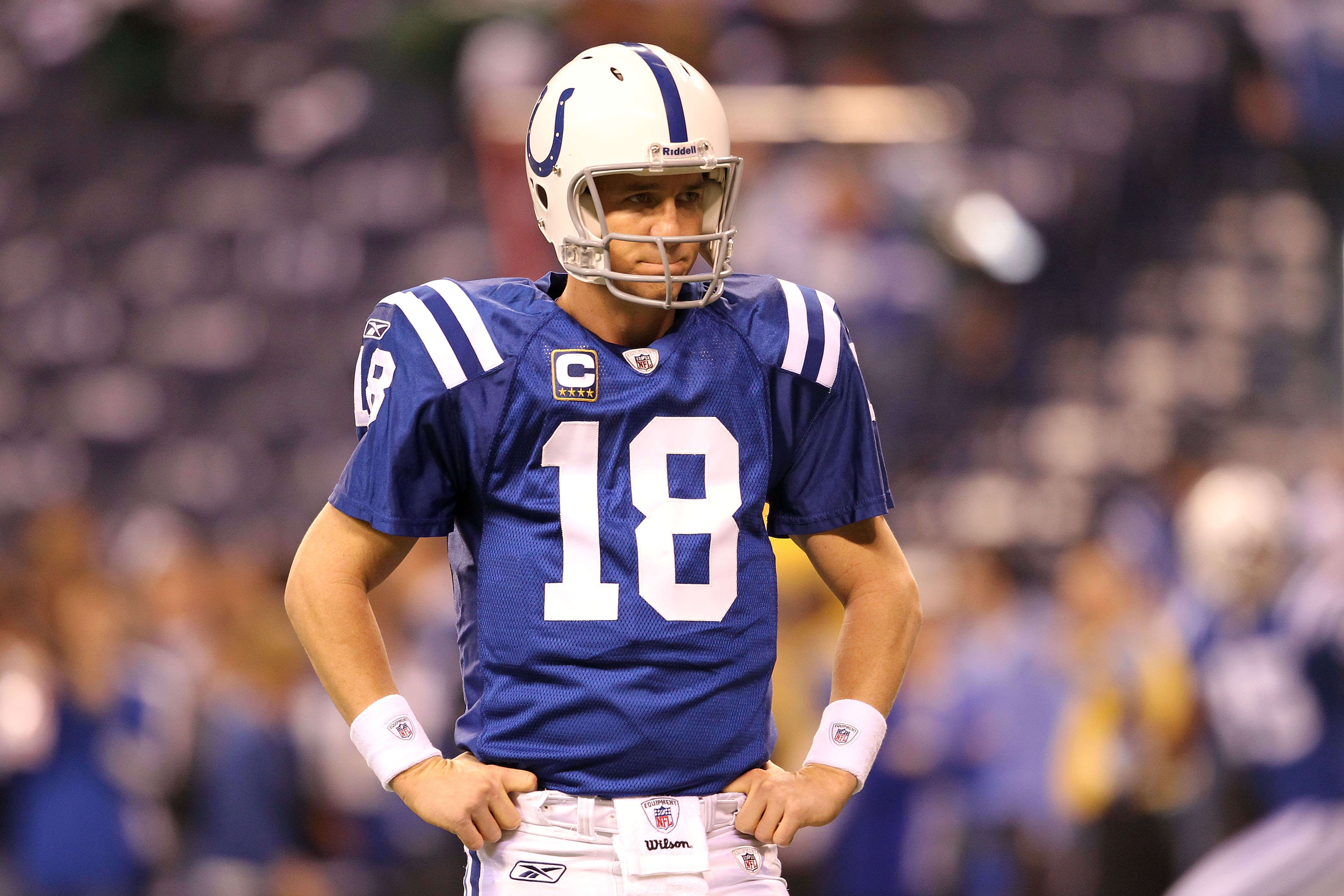 INDIANAPOLIS, IN - JANUARY 08:  Quarterback Peyton Manning #18 of the Indianapolis Colts looks on during warm ups against the New York Jets during their 2011 AFC wild card playoff game at Lucas Oil Stadium on January 8, 2011 in Indianapolis, Indiana.  (Ph