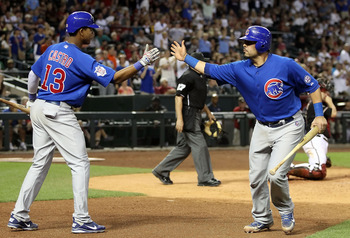 PHOENIX, AZ - APRIL 30:  Geovany Soto #18 of the Chicago Cubs high fives teammate Starlin Castro #13 after scoring against the Arizona Diamondbacks during the ninth inning of the Major League Baseball game at Chase Field on April 30, 2011 in Phoenix, Ariz