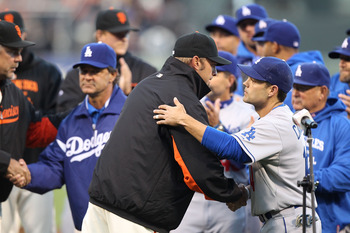 SAN FRANCISCO, CA - APRIL 11:  Jeremy Affeldt # 41 of the San Francisco Giants shakes hands with Jamey Carroll #14 of the Los Angeles Dodgers after speaking about Brian Stow, the Giants fan who was attacked last week at a Dodgers game in Los Angeles, befo