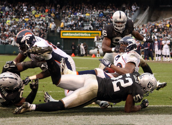 OAKLAND, CA - DECEMBER 19:  Quentin Groves #52 of the Oakland Raiders stops Correll Buckhalter #28 of the Denver Broncos for a safety at Oakland-Alameda County Coliseum on December 19, 2010 in Oakland, California.  (Photo by Ezra Shaw/Getty Images)