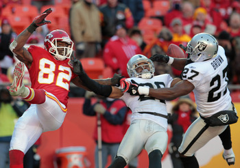 KANSAS CITY, MO - JANUARY 02:  Stevie Brown #27 of the Oakland Raiders breaks up a pass intended for Dwayne Bowe #82 of the Kansas City Chiefs during the game on January 2, 2011 at Arrowhead Stadium in Kansas City, Missouri.  (Photo by Jamie Squire/Getty