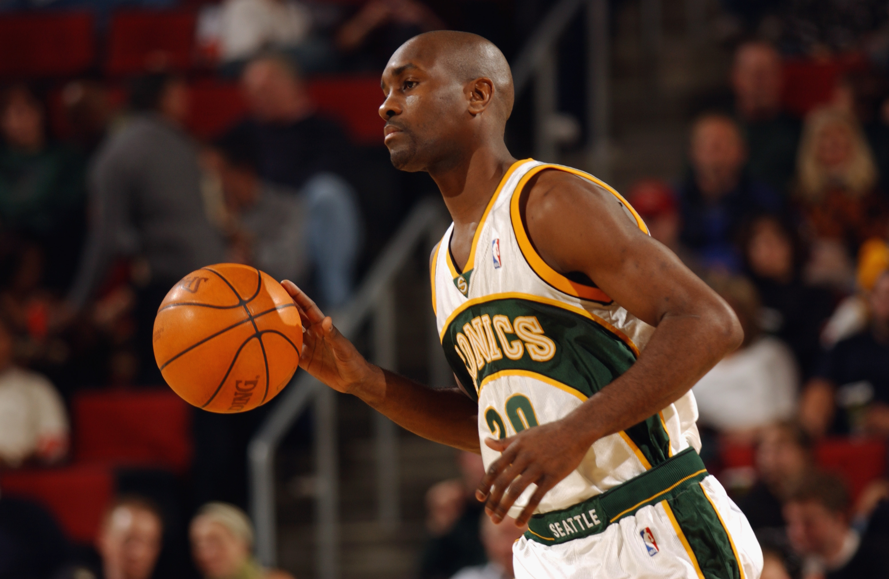SEATTLE - OCTOBER 30:  Gary Payton #20 of the Seattle Sonics moves the ball upcourt during the game against the Phoenix Suns at Key Arena on October 30, 2002 in Seattle, Washington.  The Sonics won 86-73.  NOTE TO USER: User expressly acknowledges and agr