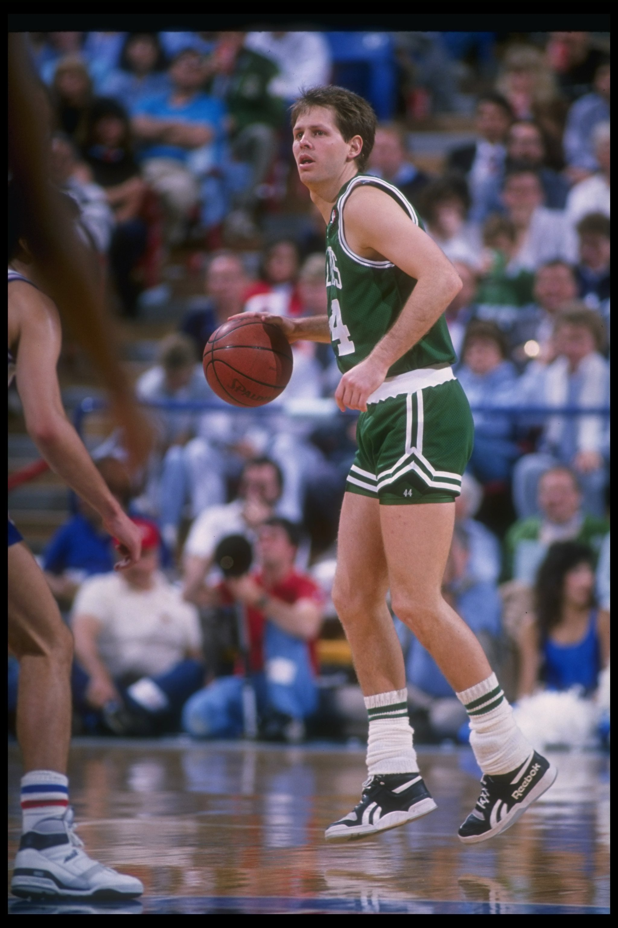 Danny Ainge of the Boston Celtics moves the ball during a game.