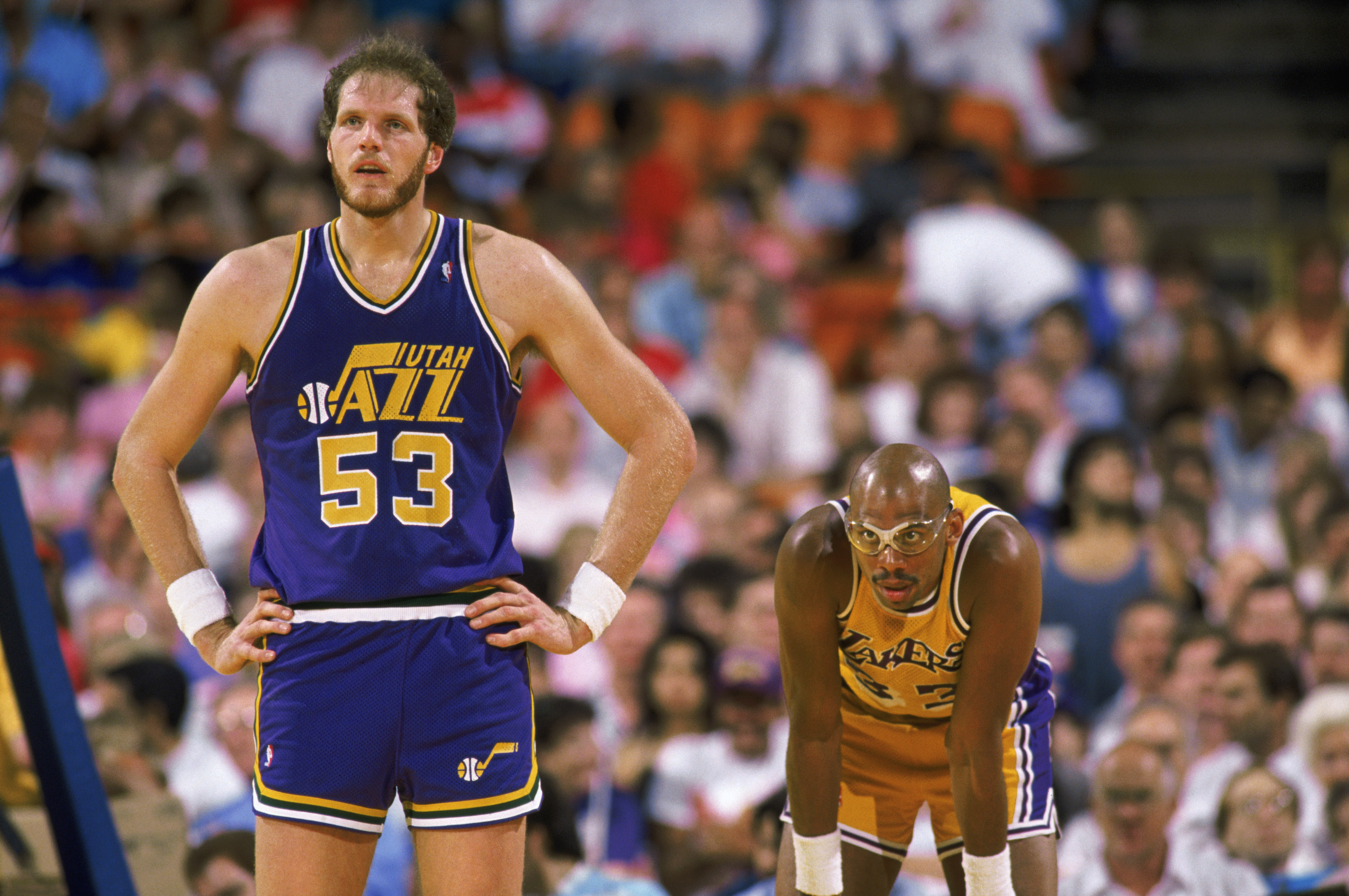 SALT LAKE CITY - 1989:  Mark Eaton #53 of the Utah Jazz stands next to Kareem Abdul-Jabbar #33 of the Los Angeles Lakers during an NBA game at The Salt Palace in Salt Lake City, Utah in 1989. (Photo by Mike Powell/Getty Images)