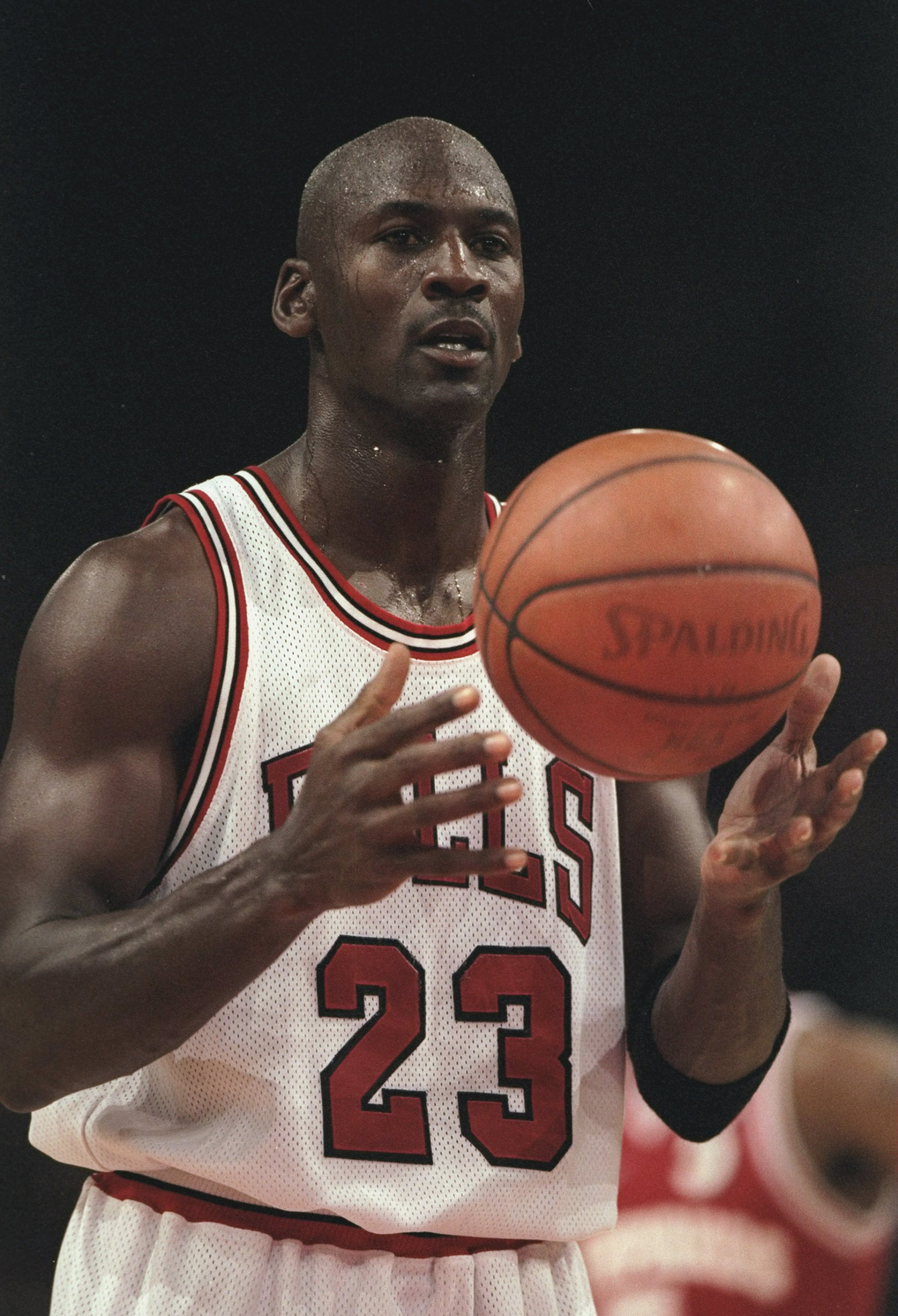 18 Oct 1997:  Guard Michael Jordan #23 of the Chicago Bulls begins to shoot a free throw during an exhibition game between the Chicago Bulls and the Olympiakos during the McDonald''s Championship at the Palais  Omnisports De Paris-Bercy in Paris, France.