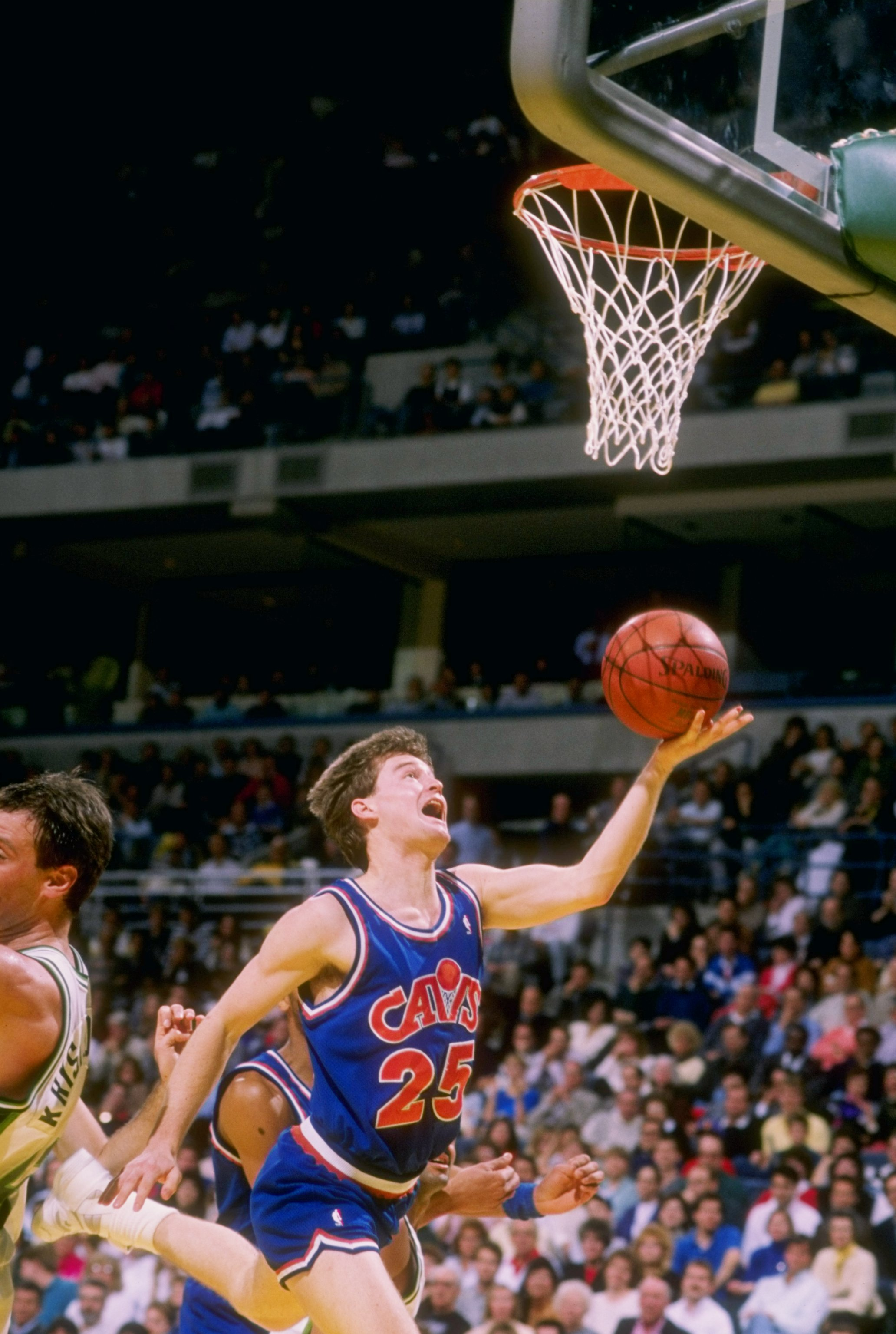 Guard Mark Price of the Cleveland Cavaliers heads for the basket during a game.