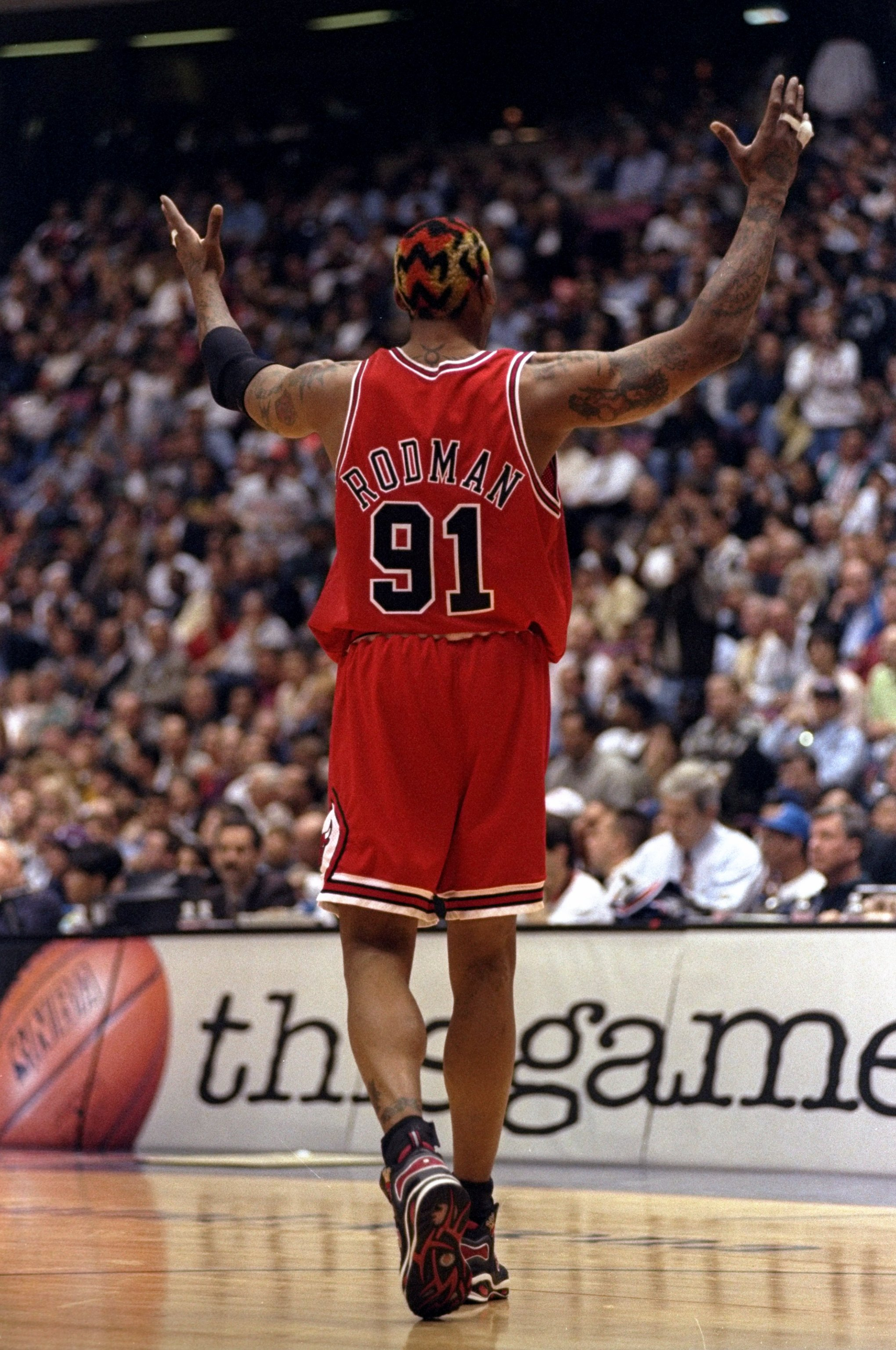 29 Apr 1998:  Dennis Rodman #91 of the Chicago Bulls gestures during a First Round Playoff Game against the New Jersey Nets at the Continental Airlines Arena in East Rutherford, New Jersey. The Bulls defeated the Nets 116-101.