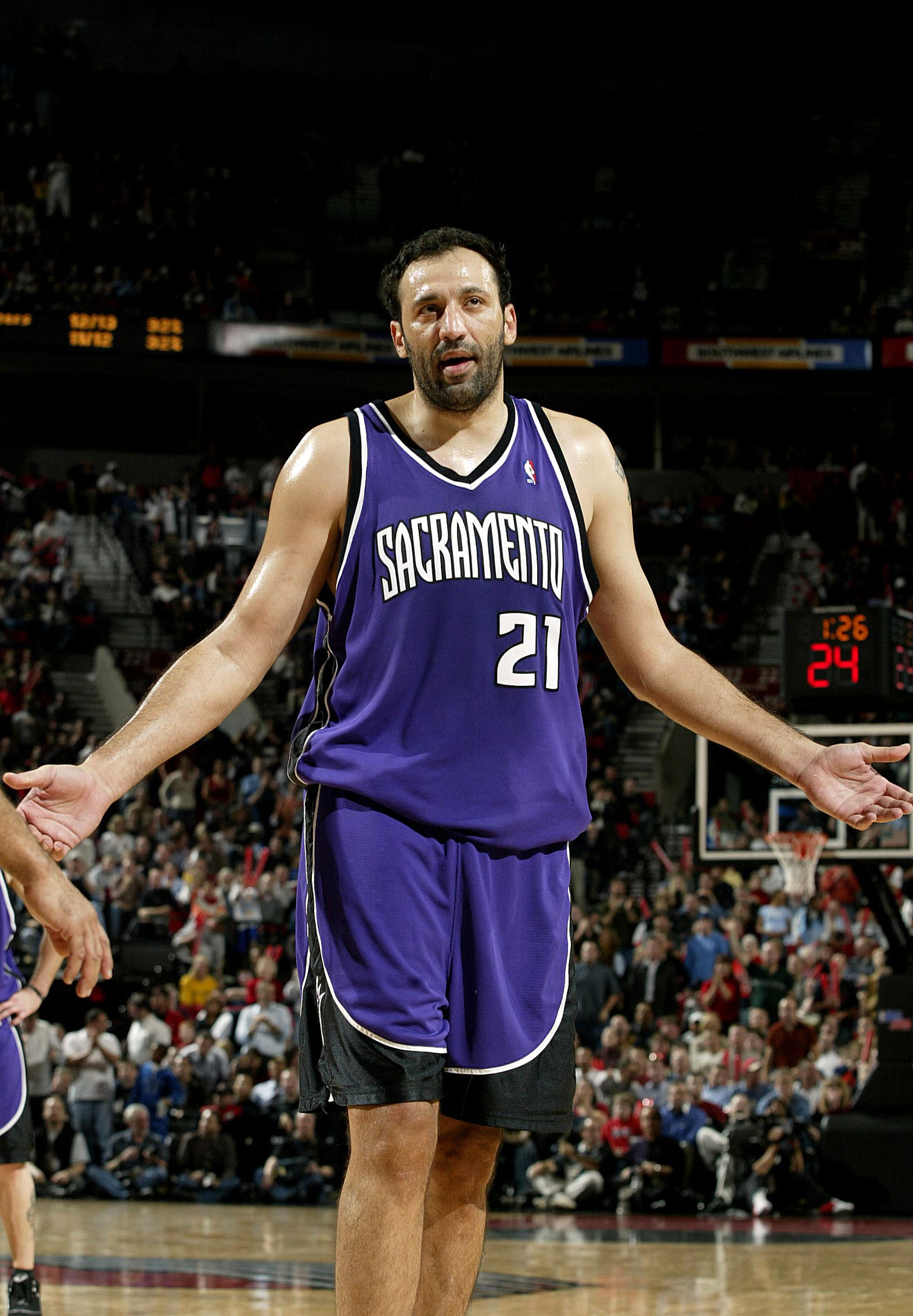 PORTLAND, OR - NOVEMBER13:  Vlade Divac #21 of the Sacramento Kings reacts to fouling out against the Portland Trail Blazers November 13, 2003 at the Rose Garden in Portland, Oregon.  NOTE TO USER: User expressly acknowledges and agrees that, by downloadi