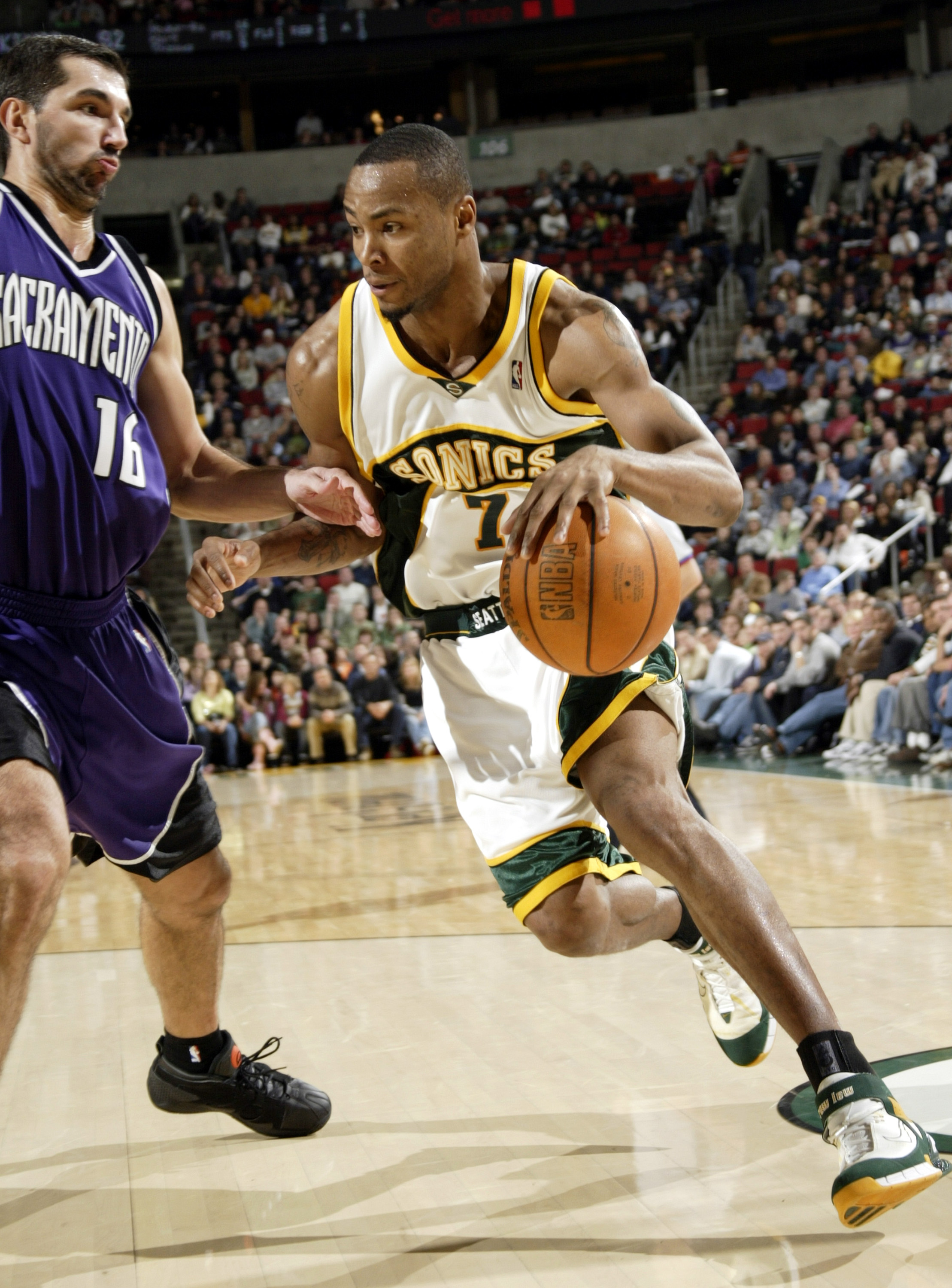 SEATTLE - NOVEMBER 20:  Rashard Lewis #7 of the Seattle SuperSonics drives against Peja Stojakovic #54 of the Sacramento Kings on November 20, 2005 at Key Arena in Seattle, Washington.  NOTE TO USER: User expressly acknowledges and agrees that, by downloa