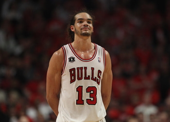 CHICAGO, IL - APRIL 26: Joakim Noah #13 of the Chicago Bulls smiles at family in the stands near the end of a win over the Indiana Pacers in Game Five of the Eastern Conference Quarterfinals in the 2011 NBA Playoffs at the United Center on April 26, 2011
