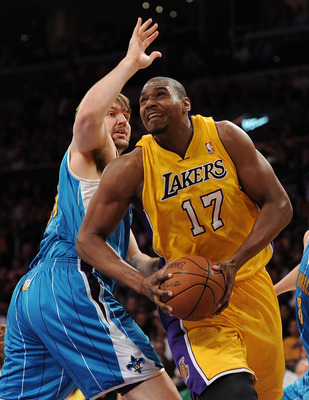 LOS ANGELES, CA - APRIL 20:  Andrew Bynum #17 of the Los Angeles Lakers makes a move on Aaron Gray #34 of the New Orleans Hornets in Game Two of the Western Conference Quarterfinals in the 2011 NBA Playoffs on April 20, 2011 at Staples Center in Los Angel