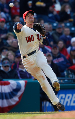 CLEVELAND - APRIL 01:  Jack Hannahan #9 of the Cleveland Indians throws the ball to first base during the Opening Day game against the Chicago White Sox on April 1, 2011 at Progressive Field in Cleveland, Ohio.  (Photo by Jared Wickerham/Getty Images)