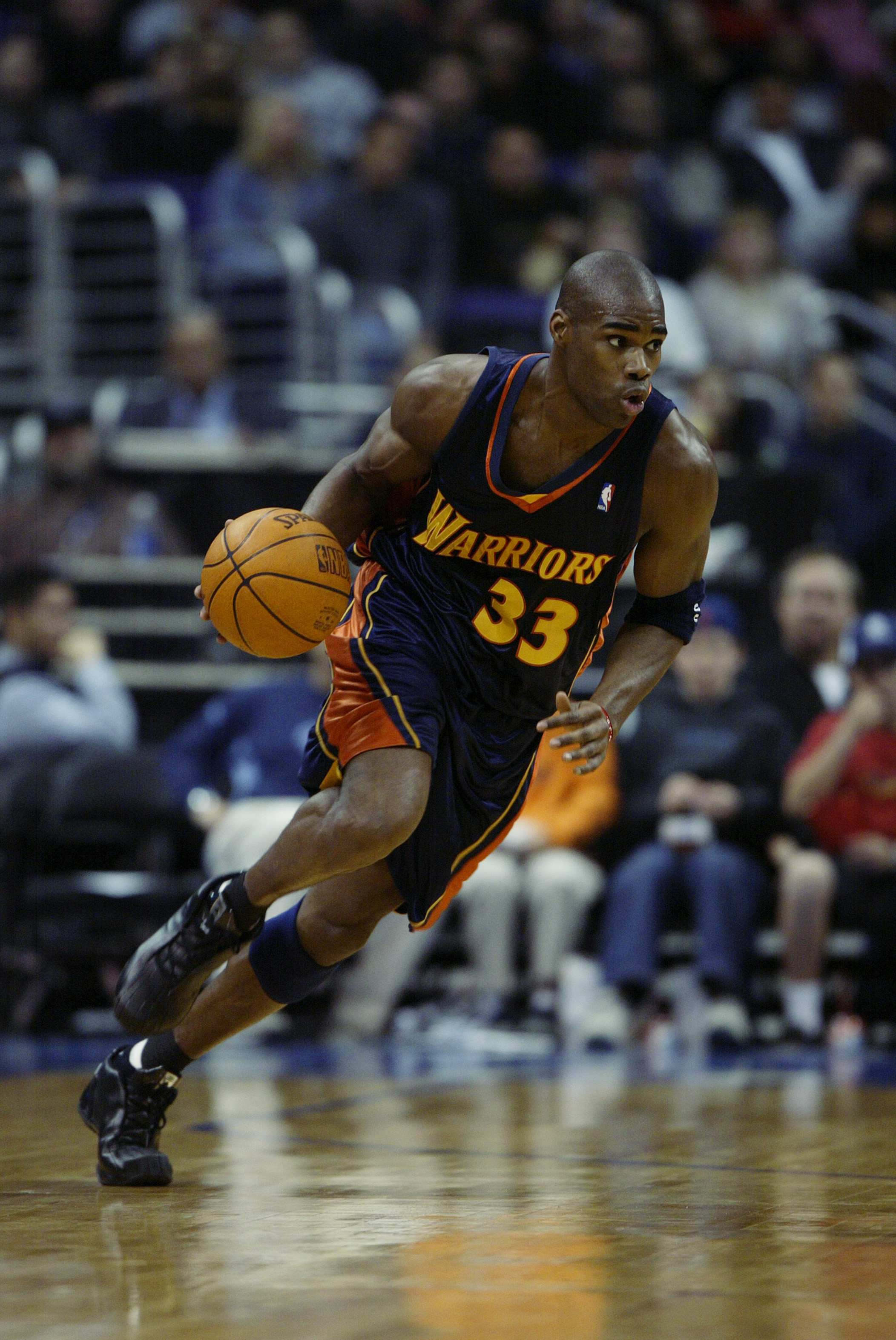LOS ANGELES - FEBRUARY 26:  Antawn Jamison #33 of the Golden State Warriors handles the ball during the NBA game against the Los Angeles Clippers at Staples Center on February 26, 2003 in Los Angeles, California.  The Warriors won 108-94.  NOTE TO USER: U