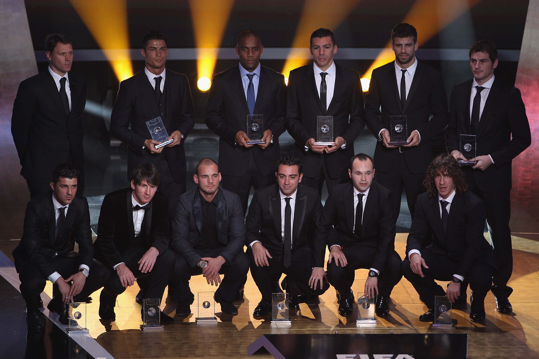 ZURICH, SWITZERLAND - JANUARY 10:  Fifa World XI award players back row l to r: Marco Van Basten who presented the award,Ronaldo,Maicon,Lucio,Gerard Pique,Iker Casillas, front row l to r: David Villa,Lionel Messi,Wesley Sneijder,Xavi,Andres Iniesta,Puyol