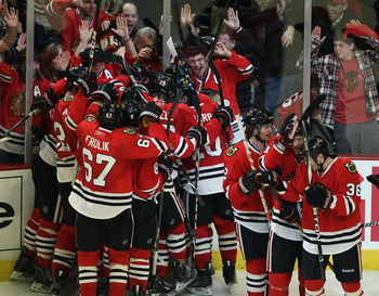 CHICAGO, IL - APRIL 24: Members of the Chicago Blackhawks celebrate an overtime win against the Vancouver Canucks in Game Six of the Western Conference Quarterfinals during the 2011 NHL Stanley Cup Playoffs at the United Center on April 24, 2011 in Chicag