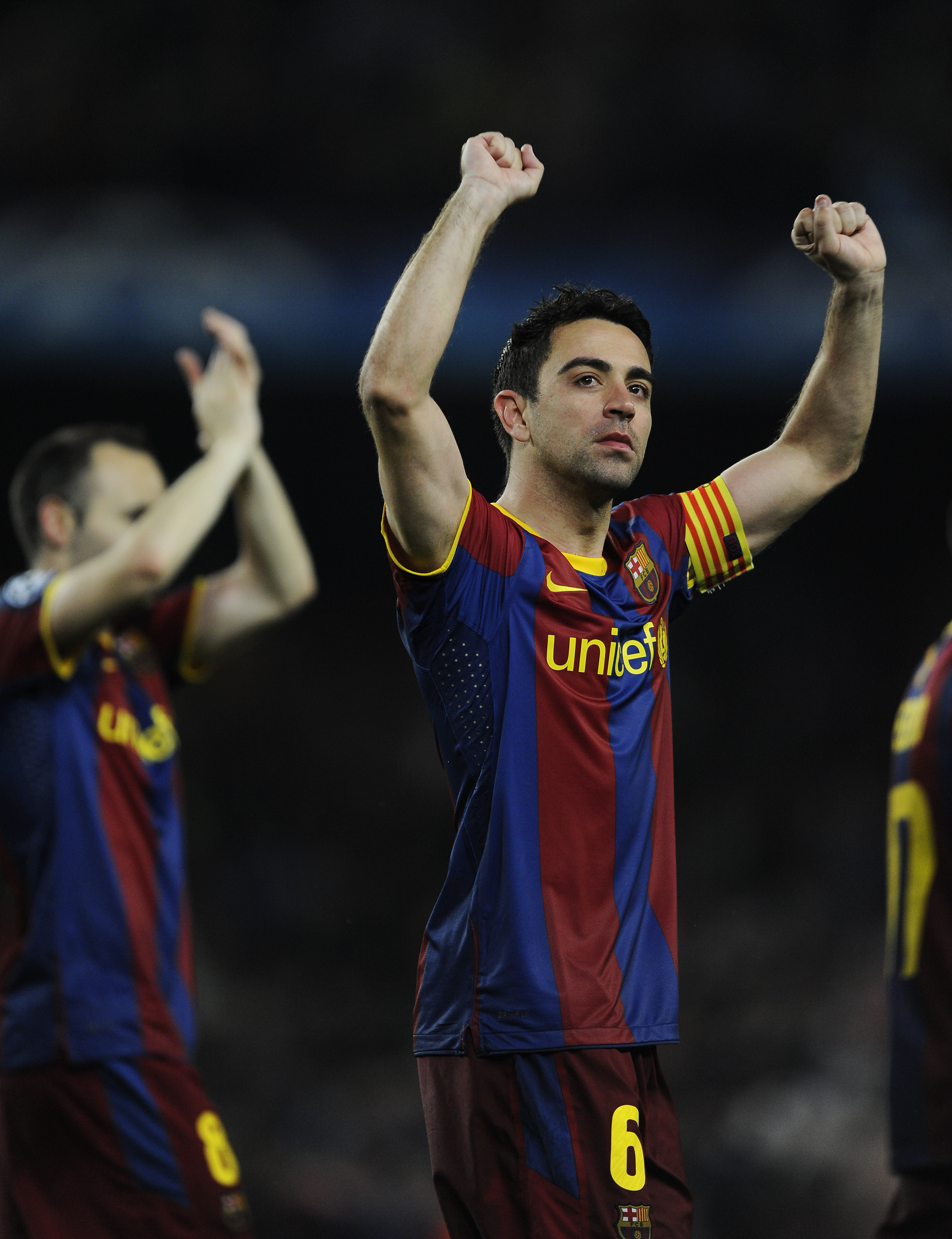 BARCELONA, SPAIN - MAY 03:  Xavi Hernandez of FC Barcelona celebrates after defeating Real Madrid at the end of the UEFA Champions League Semi Final second leg match between Barcelona and Real Madrid, at the Camp Nou on May 3, 2011 in Barcelona, Spain.  (