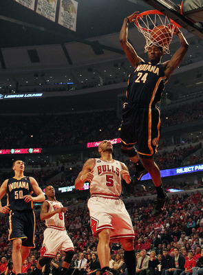CHICAGO, IL - APRIL 16: Paul George #24 of the Indiana Pacers dunks the ball over Carlos Boozer #5 of the Chicago Bulls in Game One of the Eastern Conference Quarterfinals in the 2011 NBA Playoffs at the United Center on April 16, 2011 in Chicago, Illinoi