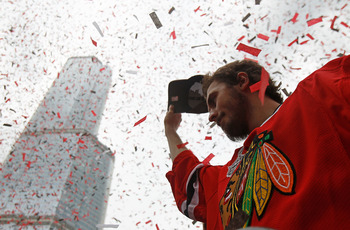 CHICAGO - JUNE 11: Dave Bolland #36 waves to the crowd during the Chicago Blackhawks Stanley Cup victory parade and rally on June 11, 2010 in Chicago, Illinois. (Photo by Jonathan Daniel/Getty Images)