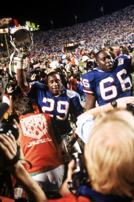 TAMPA, FL - JANUARY 27:  Safety Myron Guyton #29 and offensive tackle William Roberts #66 of the New York Giants walk off the field following the game against the Buffalo Bills during Super Bowl XXV at Tampa Stadium on January 27, 1991 in Tampa, Florida.
