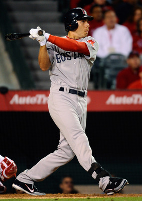 ANAHEIM, CA - APRIL 21:  Jacoby Ellsbury #2 of the Boston Red Sox hits a two run single against the Los Angeles Angels of Anaheim to score teammates David Ortiz #34 and Jed Lowrie # 12 during the sixth inning of the baseball game at Angel Stadium of Anahe