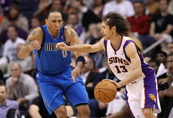 PHOENIX, AZ - MARCH 27:  Steve Nash #13 of the Phoenix Suns drives the ball past Shawn Marion #0 of the Dallas Mavericks during the NBA game at US Airways Center on March 27, 2011 in Phoenix, Arizona.  NOTE TO USER: User expressly acknowledges and agrees