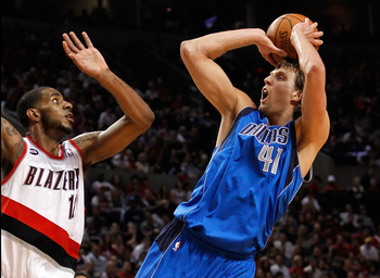 PORTLAND, OR - APRIL 23:  LaMarcus Aldrdige #12 of the Portland Trail Blazers defends Dirk Nowitzki #41 of the Dallas Mavericks in Game Four of the Western Conference Quarterfinals in the 2011 NBA Playoffs on April 23, 2011 at the Rose Garden in Portland,