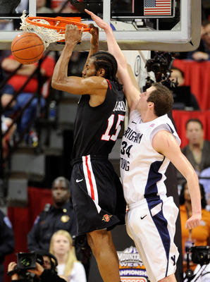 LAS VEGAS, NV - MARCH 12:  Kawhi Leonard #15 of the San Diego State Aztecs dunks in front of Noah Hartsock #34 of the Brigham Young University Cougars during the championship game of the Conoco Mountain West Conference Basketball tournament at the Thomas