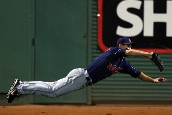 BOSTON - OCTOBER 20:  Grady Sizemore #24 of the Cleveland Indians dives to catch a ball hit by Jacoby Ellsbury #46 of the Boston Red Sox in the fourth inning of Game Six of the American League Championship Series at Fenway Park on October 20, 2007 in Bost